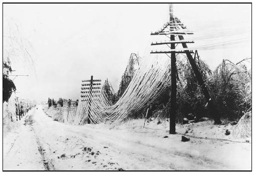 Heavy ice and snow can disrupt transportation, communication, and utilities. (Photo courtesy of National Oceanic and Atmospheric Administration (NOAA) Central Library.)
