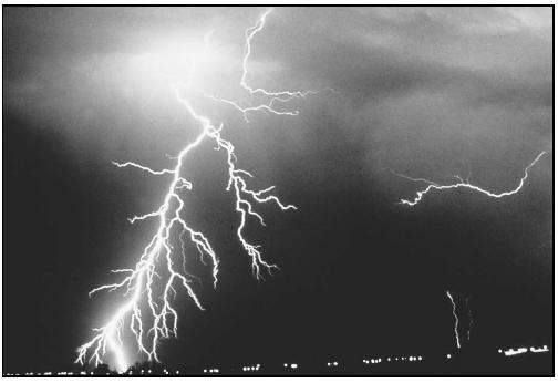 It is estimated that lightning flashes occur somewhere on Earth about 100 times each second. (Photo by C. Clark. Courtesy of NOAA Photo Library, NOAA Central Library; OAR/ERL/National Severe Storms Laboratory (NSSL).)