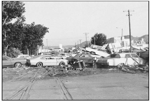 The force of a flash flood carried these cars downstream. (Photo courtesy of National Oceanic and Atmospheric Administration (NOAA) Central Library.)